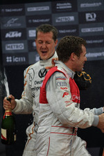 Podium: Michael Schumacher and Tom Kristensen