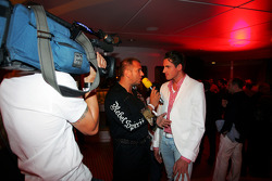 Kai Ebel RTL TV Presenter and Adrian Sutil Force India F1 at the Fly Kingfisher Boat Party