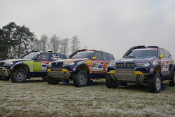 X-raid team: the #330 BMW X3 CC of René Kuipers and Filipe Palmeiro, the #302 BMW X3 CC of Nasser Al Attiyah and Tina Thorner, the #318 BMW X3 CC of Peter van Merksteijn and Eddy Chevaillier