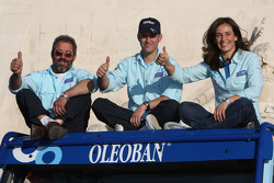 Olzoban Man Portugal Man presentation in Lisbon: driver Elisabete Jacinto, co-driver Alvaro Velhinho, and co-driver Marco Cochinho pose with Olzoban Man Portugal Man team members and vehicles
