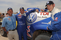 Car category winners Giniel De Villiers and Dirk Von Zitzewitz, celebrate with Volkswagen Motorsport director Kris Nissen