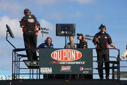 Hendrick Motorsports Chevrolet crew members watch practice from atop their hauler