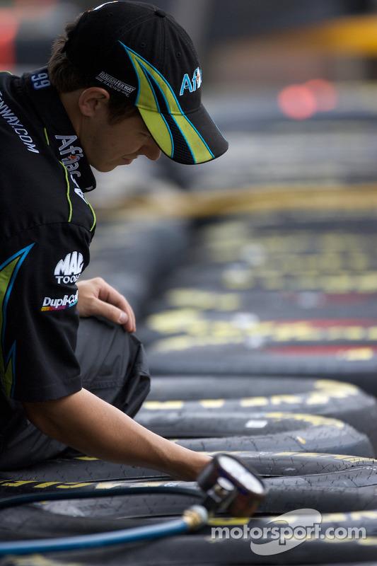 Roush Fenway Racing Ford crew member prepares wheels