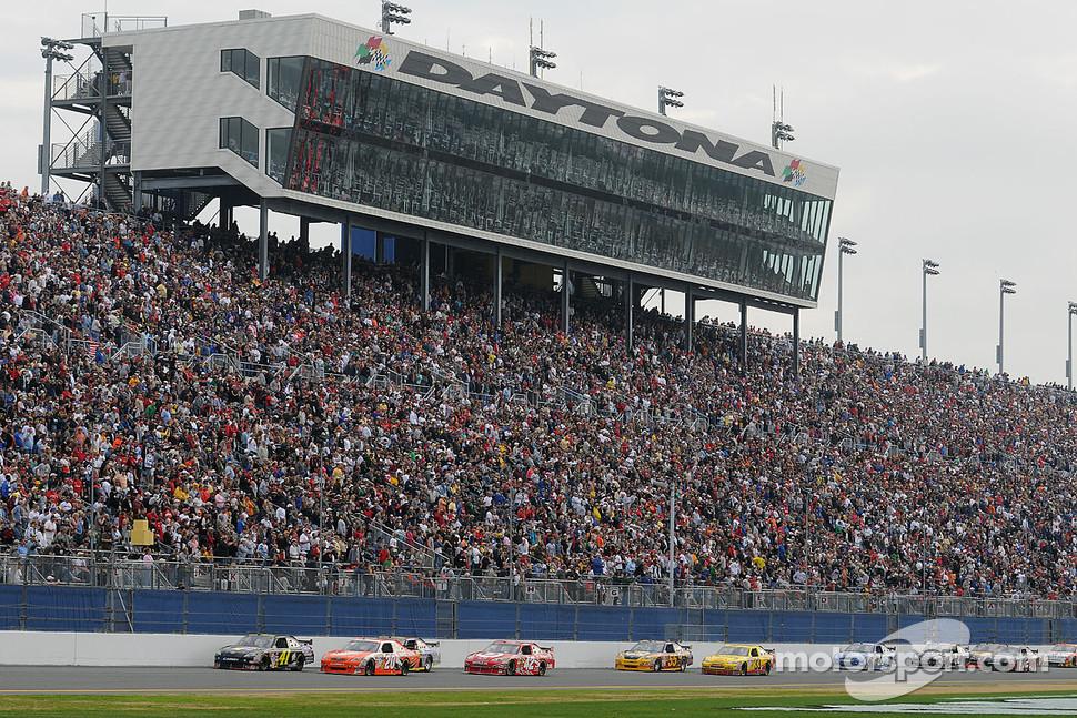 Jeremy Mayfield, Mayfield Motorsports Toyota, and Joey Logano, Joe Gibbs Racing Toyota, lead a group