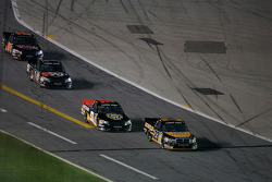 Jason White, Kyle Busch and Johnny Benson on pit road