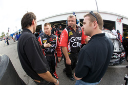 Jason Leffler talks with his crew after a crash