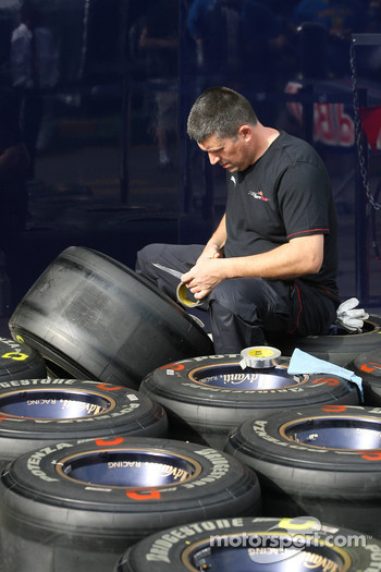 Toro Rosso mechanic with Bridgestone tyres