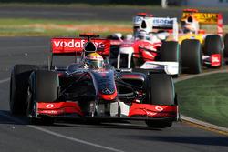 Lewis Hamilton, McLaren Mercedes, MP4-24 leads Jarno Trulli, Toyota Racing, TF109