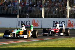 Giancarlo Fisichella, Force India F1 Team leads Jarno Trulli, Toyota Racing, TF109