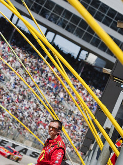 Richard Petty Motorsports Dodge crew member watches the race