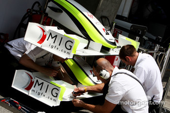 Brawn GP mechanics working on the front wings