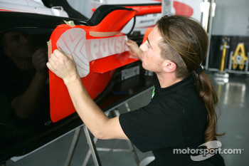 A Fisichella Motor Sport International mechanic at work