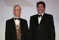 The NASCAR Sprint Cup Series' first championship-winning car owner, Raymond Parks, displays his International Motorsports Hall of Fame medal after being inducted by NASCAR President Mike Helton