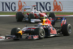 Sebastian Vettel, Red Bull Racing and Jarno Trulli, Toyota F1 Team