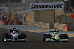 Jenson Button, Brawn GP and Robert Kubica, BMW Sauber F1 Team