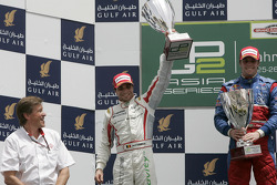 Luiz Razia celebrates his first GP2 Asia win on the podium with Jerome D'Ambrosio
