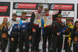 GT podium: class winners Leh Keen and Dirk Werner, second place Ted Ballou and Spencer Pumpelly, third place Eric Lux and Bryan Sellers