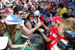 Felipe Massa, Scuderia Ferrari signing autographs for the fans