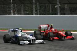 Nick Heidfeld, BMW Sauber F1 Team and Kimi Raikkonen, Scuderia Ferrari