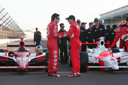Dario Franchitti visits with Helio Castroneves before the front row photo shoot