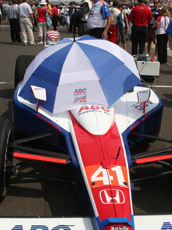 An umbrella shades A.J.Foyt IV's car before the race