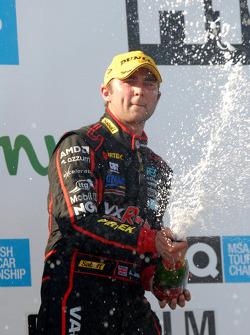 Andrew Jordan sprays champagne