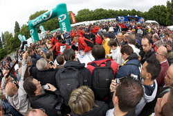 A massive crowd watches the Audi R15 TDI cars