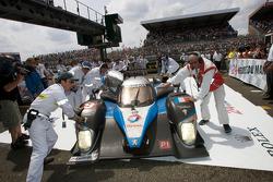 The race winning #9 Team Peugeot Total Peugeot 908 enters Parc Fermé driven by Marc Gene