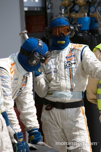 Aston Martin Racing team members ready for a pit stop