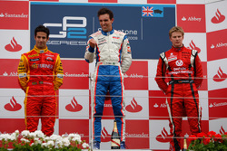Alberto Valerio celebrates his victory on the podium with Lucas Di Grassi and Nico Hulkenberg