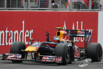 Sebastian Vettel, Red Bull Racing, takes the checkered flag