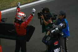 Race winner Hironobu Yasuda celebrates