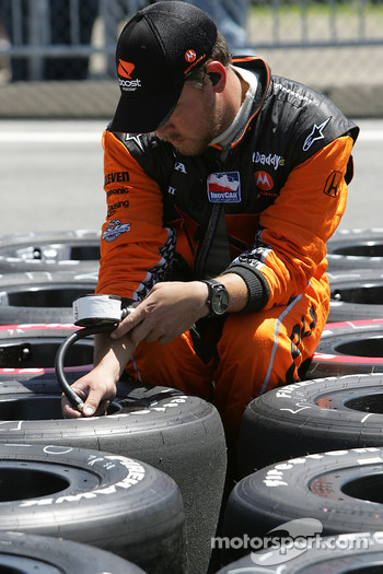 Andretti Green Racing team member prepares the tires