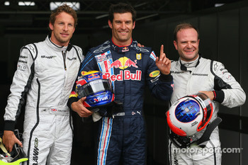 Pole winner Mark Webber, Red Bull Racing with second place Rubens Barrichello, Brawn GP,  and third place Jenson Button, Brawn GP