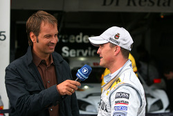 Ralf Schumacher, Team HWA AMG Mercedes, being interviewed for German TV after finishing last in the qualifying