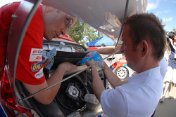 Mechanics add ice to help keep things cool in the engine department just prior to the run up Pikes Peak
