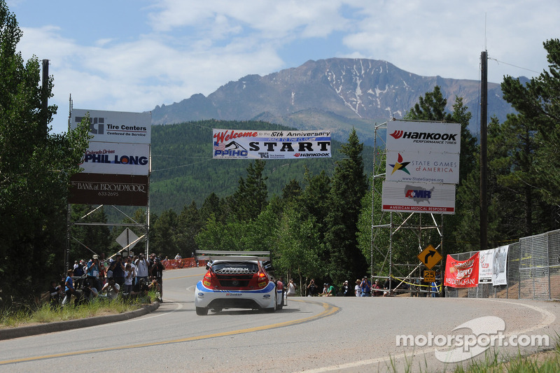 Marcus Gronholm takes a flying start on his way to the top of Pikes Peak in the background