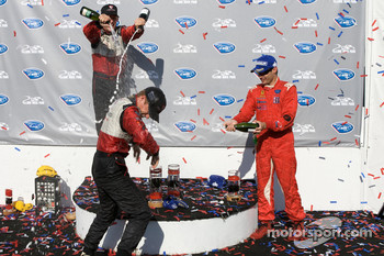 GT2 podium: Jorg Bergmeister, Patrick Long and Jaime Melo celebrate with champagne