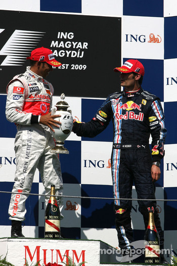 Podium: race winner Lewis Hamilton, McLaren Mercedes, third place Mark Webber, Red Bull Racing