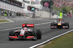 Heikki Kovalainen, McLaren Mercedes leads Sebastian Vettel, Red Bull Racing