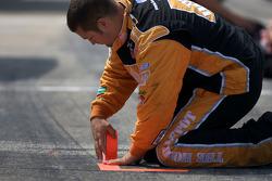 Joe Gibbs Racing Toyota crew member prepares pit area