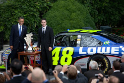 President Barack Obama and three-time defending NASCAR Sprint Cup Series champion Jimmie Johnson pose with the NASCAR Sprint Cup trophy during a ceremony honoring the No. 48 Hendrick Motorsports team at the White House in Washington, D.C.