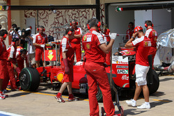 Michael Schumacher, Test Driver, Scuderia Ferrari looks at the car of Kimi Raikkonen, Scuderia Ferrari