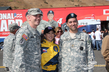 Olympic figure skating gold medalist Kristi Yamaguchi pose with armed force members