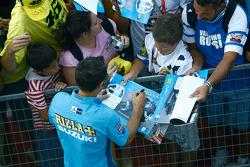 Loris Capirossi, Rizla Suzuki MotoGP signs autographs