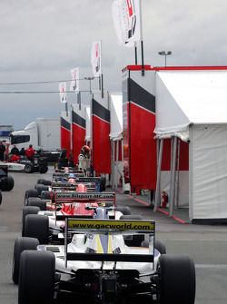 Alex Brundle and other F2 cars line up in the paddock