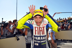 Race winner Valentino Rossi, Fiat Yamaha Team celebrates with a donkey routine