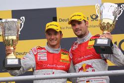 Timo Scheider and Martin Tomczyk celebrate their podiums