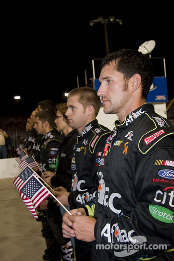 Carl Edward's Aflac crew listen to the national anthem