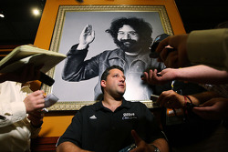 Two-time NASCAR Sprint Cup Series driver Tony Stewart answers a question under a picture of the late Jerry Garcia, Grateful Dead guitarist, Thursday at the Hard Rock Cafe